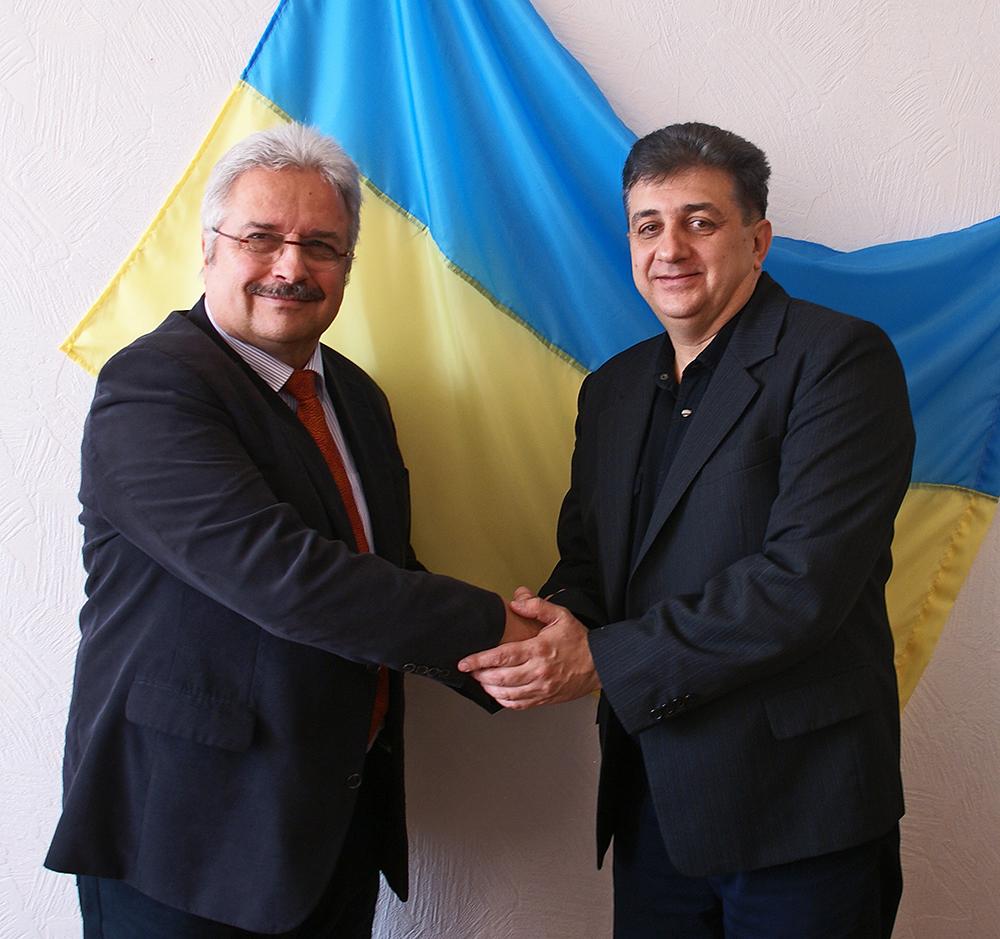Handschlag mit dem Landesrat Yuriy Viktorovych Stetsyuk
