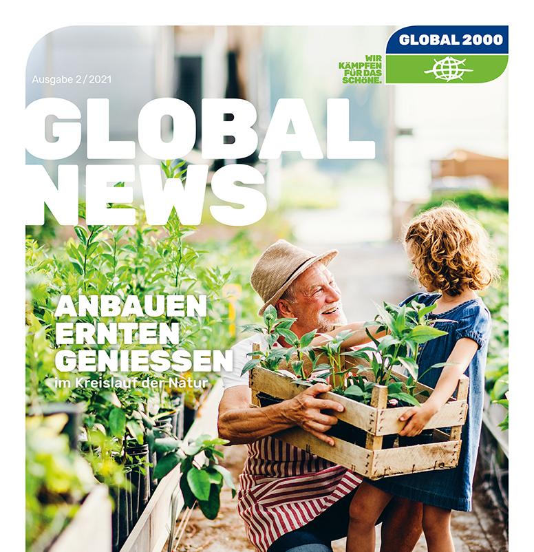 Großvater und Enkeltochter bauen Gemüse an