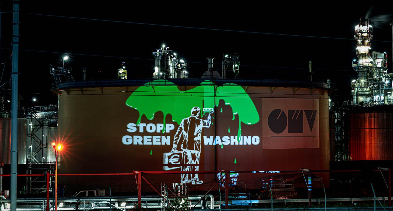 Projektion auf OMV-Tank: Stopp Greenwashing